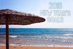 Writing note showing 2018 New Years Goals. Business photo showcasing resolution List of things you want to achieve Blue beach san. D message idea sunshade water royalty free illustration