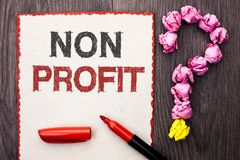 Writing note showing Non Profit. Business photo showcasing Charitable Wrothless Philanthropy Aid Unlucrative Profitless written o. Writing note showing Non stock photo
