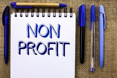 Writing note showing Non Profit. Business photo showcasing Charitable Wrothless Philanthropy Aid Unlucrative Profitless written o. Writing note showing Non royalty free stock image