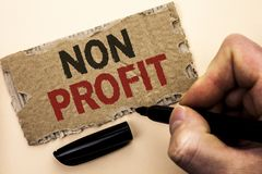 Writing note showing Non Profit. Business photo showcasing Charitable Wrothless Philanthropy Aid Unlucrative Profitless written b. Y Man Holding Marker tear stock image
