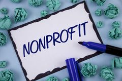 Writing note showing  Nonprofit. Business photo showcasing Activities that do not generate revenues to the executor written on Sti. Writing note showing Royalty Free Stock Photography