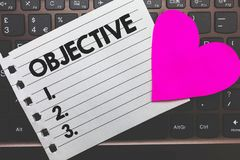 Writing note showing Objective. Business photo showcasing Goal planned to be achieved Desired target Company mission Small paper d. Iary page love heart office royalty free stock images