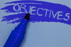 Writing note showing Objectives. Business photo showcasing Goals planned to be achieved Desired targets Company missions Bold blue. Marker colouring sketch work royalty free stock images