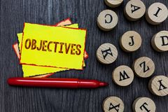 Writing note showing Objectives. Business photo showcasing Goals planned to be achieved Desired targets Company missions Multiple. Small sticky cards wood stock photos