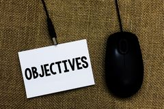 Writing note showing Objectives. Business photo showcasing Goals planned to be achieved Desired targets Company missions Sticky ca. Rd type text convey message royalty free stock photography