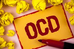 Writing note showing  Ocd. Business photo showcasing Obsessive Compulsive Disorder Psychological Illness Medical Condition written. Sticky Note paper within Stock Images