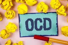 Writing note showing  Ocd. Business photo showcasing Obsessive Compulsive Disorder Psychological Illness Medical Condition written. Sticky note paper within Royalty Free Stock Image