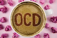 Writing note showing  Ocd. Business photo showcasing Obsessive Compulsive Disorder Psychological Illness Medical Condition written. Coffee in White Cup within Stock Photo