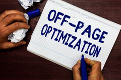 Writing note showing Off Page Optimization. Business photo showcasing Website External Process Promotional Method. Ranking Man holding marker notebook page stock photo