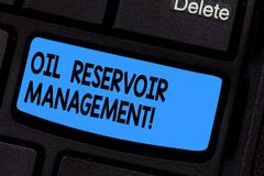 Writing note showing Oil Reservoir Management. Business photo showcasing analysisaging the recovery of natural gas from. Rock Keyboard key Intention to create stock photography