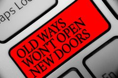 Writing note showing Old Ways Won t not Open New Doors. Business photo showcasing be different and unique to Achieve goals Keyboar. D red key Intention computer stock photography