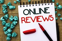 Writing note showing  Online Reviews. Business photo showcasing Internet Evaluations Customer Rating Opinions Satisfaction written. Notebook Book the jute Stock Photo