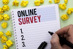 Writing note showing  Online Survey. Business photo showcasing Digital Media Poll Customer Feedback Opinions Questionnaire written. By Man Holding Marker Stock Photography