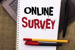 Writing note showing  Online Survey. Business photo showcasing Digital Media Poll Customer Feedback Opinions Questionnaire written. Notebook Book placed Laptop Stock Image
