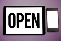 Writing note showing Open. Business photo showcasing Allow things to pass through or for immediate use Contrary of closed Wide fra. Med white smart screen tablet royalty free stock photo