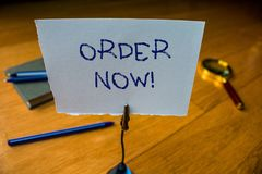 Writing note showing Order Now. Business photo showcasing confirmed request by one party to another to buy sell Reminder. Writing note showing Order Now stock photography
