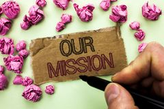 Writing note showing  Our Mission. Business photo showcasing Goal Motivation Target Growth Planning Innovation Vision written by M. An Holding Marker Tear Stock Image