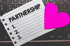 Writing note showing Partnership. Business photo showcasing Association of two or more people as partners Cooperation Unity Small. Paper diary page love heart royalty free stock photography
