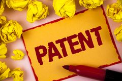 Writing note showing Patent. Business photo showcasing License that gives rights for using selling making a product written on St. Writing note showing Patent royalty free stock image