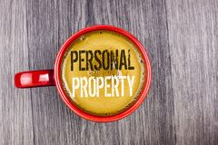 Writing note showing  Personal Property. Business photo showcasing Belongings possessions assets private individual owner written. Coffee in Red Cup the Grey Royalty Free Stock Photo