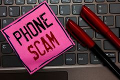 Writing note showing Phone Scam. Business photo showcasing getting unwanted calls to promote products or service Telesales Pink pa royalty free stock photo