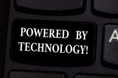 Writing note showing Powered By Technology. Business photo showcasing Breakthrough led to the broad commercialization. Keyboard key Intention to create computer royalty free stock photography