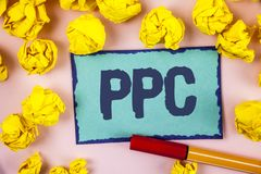 Writing note showing Ppc. Business photo showcasing Pay Per Click Advertising Strategies Direct Traffic to Websites written on St. Writing note showing Ppc royalty free stock photo