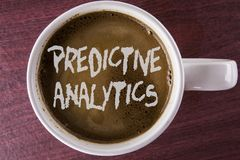 Writing note showing Predictive Analytics. Business photo showcasing Method to forecast Performance Statistical Analysis written. Coffee in White Cup the wooden royalty free stock photography