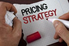 Writing note showing  Pricing Strategy. Business photo showcasing Marketing sales strategies profit promotion campaign written by. Man Tear Notebook paper Stock Photo