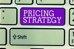 Writing note showing Pricing Strategy. Business photo showcasing set maximize profitability for unit sold or market overall.  royalty free stock image