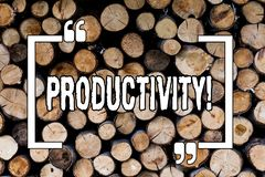 Writing note showing Productivity. Business photo showcasing Effective work Great perforanalysisce Success Wooden background royalty free stock image