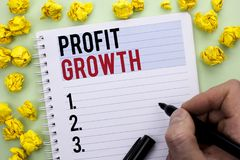 Writing note showing  Profit Growth. Business photo showcasing Financial Success Increased Revenues Evolution Development written. By Man Holding Marker Stock Images