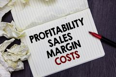 Writing note showing Profitability Sales Margin Costs. Business photo showcasing Business incomes revenues Budget earnings Marker. Over notebook crumpled papers royalty free stock image