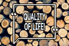 Writing note showing Quality Of Life. Business photo showcasing Good Lifestyle Happiness Enjoyable Moments Wellbeing Wooden royalty free stock images