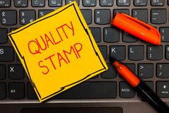 Writing note showing Quality Stamp. Business photo showcasing Seal of Approval Good Impression Qualified Passed Inspection Yellow. Paper keyboard Inspiration stock photos