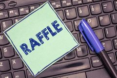 Writing note showing Raffle. Business photo showcasing means of raising money by selling numbered tickets offer as prize.  stock photos