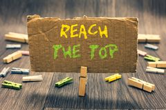 Writing note showing Reach The Top. Business photo showcasing Get Ahead Succeed Prosper Thrive for the Win Victory Clothespin hold. Ing paperboard important stock photo