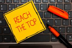 Writing note showing Reach The Top. Business photo showcasing Get Ahead Succeed Prosper Thrive for the Win Victory Yellow paper ke. Yboard Inspiration stock image