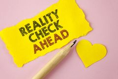 Writing note showing Reality Check Ahead. Business photo showcasing Unveil truth knowing actuality avoid being sceptical written. Tear Yellow paper piece Pink stock photos