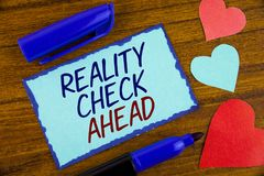 Writing note showing Reality Check Ahead. Business photo showcasing Unveil truth knowing actuality avoid being sceptical written. Sticky note paper the wooden royalty free stock image