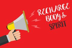Writing note showing Recharge BodyandSpirit. Business photo showcasing fill your energy through relaxation and having fun Hand sma. Ll loud speaker sound public Stock Photos