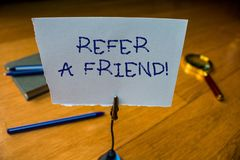 Writing note showing Refer A Friend. Business photo showcasing direct someone to another or send him something like gift. Writing note showing Refer A Friend stock images