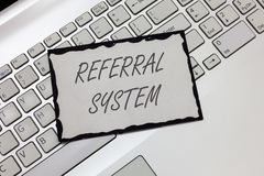 Writing note showing Referral System. Business photo showcasing sending own patient to another physician for treatment.  royalty free stock photography