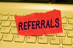Writing note showing Referrals. Business photo showcasing Act of referring someone or something for consultation review.  royalty free stock photo