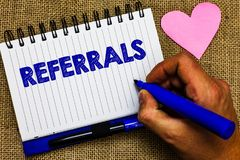 Writing note showing Referrals. Business photo showcasing Act of referring someone or something for consultation review Notepad pe. N papers ideas thoughts nice stock photography