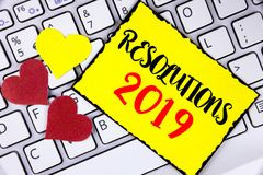 Writing note showing  Resolutions 2019. Business photo showcasing Positive reinforcement personal improvent corporate goals writte. N Yellow Sticky Note Paper Stock Photo