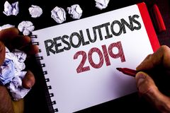 Writing note showing  Resolutions 2019. Business photo showcasing Positive reinforcement personal improvent corporate goals writte. N by Man Notepad holding Stock Photography