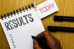 Writing note showing Results. Business photo showcasing Consequences outcomes produced by something Achievement. Development Man holding marker notebook royalty free stock photo