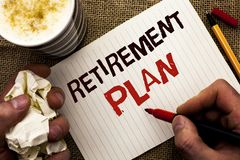 Writing note showing  Retirement Plan. Business photo showcasing Savings Investments that provide incomes for retired workers writ. Ten by Man Holding Marker Royalty Free Stock Image