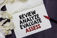 Writing note showing Review Analyze Evaluate Assess. Business photo showcasing Evaluation of performance feedback process Marker o. Writing note showing Review stock images